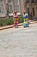 Colourfully dressed street sellers in Old Havana, Cuba.