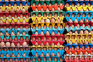 Colorful crates hold dozens of eggs in a street side market in Iquitos, Peru.