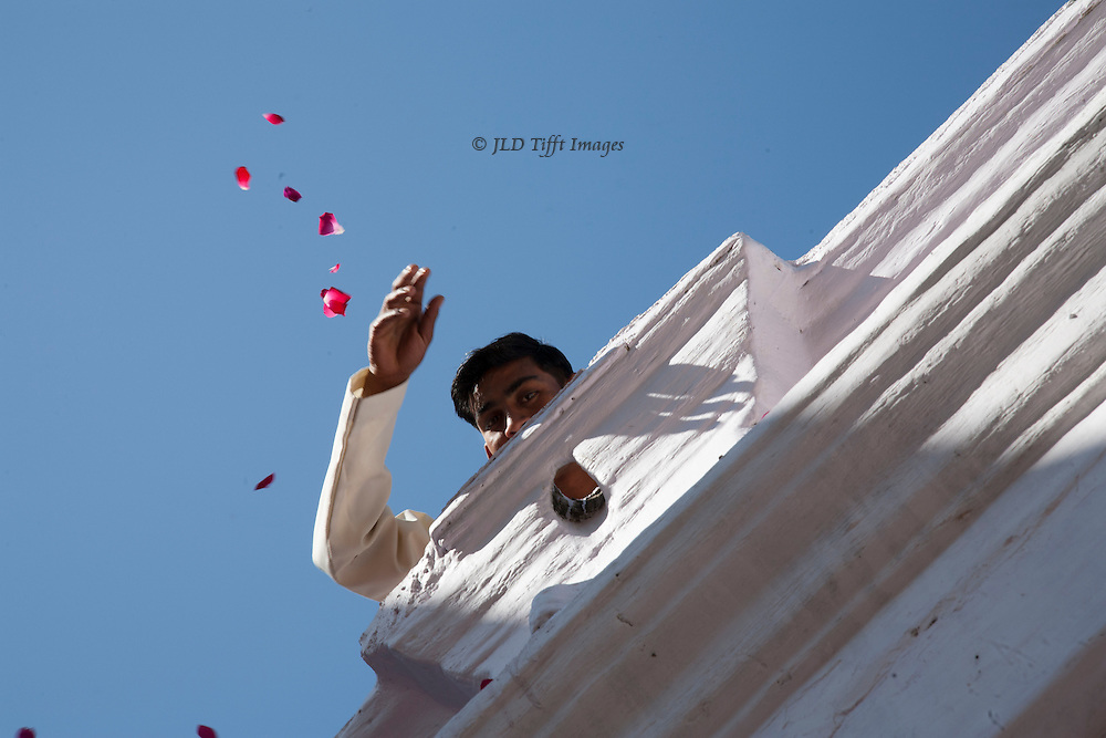 Throwing rose petals on luncheon guests at the Jambughoda restaurant and ex-maharahah palace, now a retreat center.