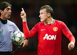 27.09.2011, Old Trafford, London, ENG, UEFA CL, Gruppe C, Manchester United (ENG) vs FC Basel (SUI), im Bild Manchester United's Phil Jones looks dejected at referee Paolo Tagliavento after his side only managed to draw against FC Basel 1893 // during the UEFA Champions League game, group C, Manchester United (ENG) vs FC Basel (SUI) at Old Trafford stadium in London, United Kingdom on 2011/09/27. EXPA Pictures © 2011, PhotoCredit: EXPA/ Propaganda Photo/ David Rawcliff +++++ ATTENTION - OUT OF ENGLAND/GBR+++++