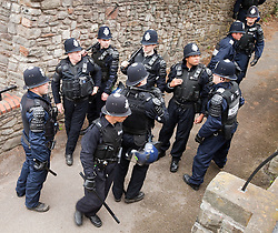 © Licensed to London News Pictures. 14/07/2012. Bristol , UK . Police congregated with their batons out following confrontations between EDL supporters and those who oppose them . The English Defence League hold a march and demonstration in Bristol . Photo credit : Joel Goodman/LNP