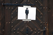 improvised temporary male toilet door sign on an old wooden door