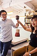THINKK Studio partners, Decha (L.) and Ploypan (R.) with Cement Wood Lamp