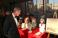 Steve Wargo looks at silent auction items during the 18th annual Heart Ball, ?Ignite the Magic? at Sinclair Community College's David H. Ponitz Center in downtown Dayton, Saturday, March 23, 2013.