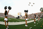 CANTON, OH - AUGUST 6:  Eagles cheerleaders raise their pompoms in pregame celebration as four U.S. Air Force jets do a fly over prior to the Oakland Raiders game against the Philadelphia Eagles during the AFC-NFC Pro Football Hall of Fame Game at Fawcett Stadium on August 6, 2006 in Canton, Ohio. The Raiders defeated the Eagles 16-10. ©Paul Anthony Spinelli