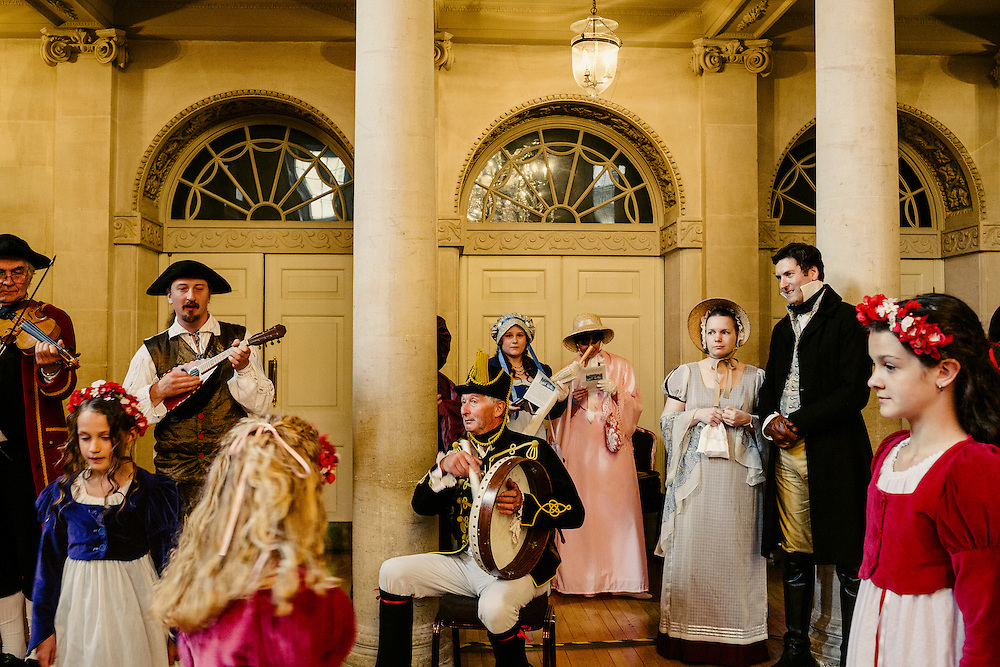 Inside the Assembly Rooms, on Saturday, 15 Sept 2014, Bath stepped back in time to its Georgian heyday. The streets were full of Jane Austen enthusiasts dressed up in Regency costume for the Jane Austen Festival Grand Regency Costumed Promenade. It started at the historic Georgian Assembly Rooms, where a new world record was successfully set for the most people dressed up in Regency costume in one site before it continued through to some of the most iconic places of Bath and ended in the Parade Gardens.