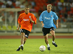BANGKOK, THAILAND - Wednesday, July 23, 2003: Liverpool's Milan Baros (l) and Stephane Henchoz during a training session in at the Rajamangala National Stadium. (Pic by David Rawcliffe/Propaganda)