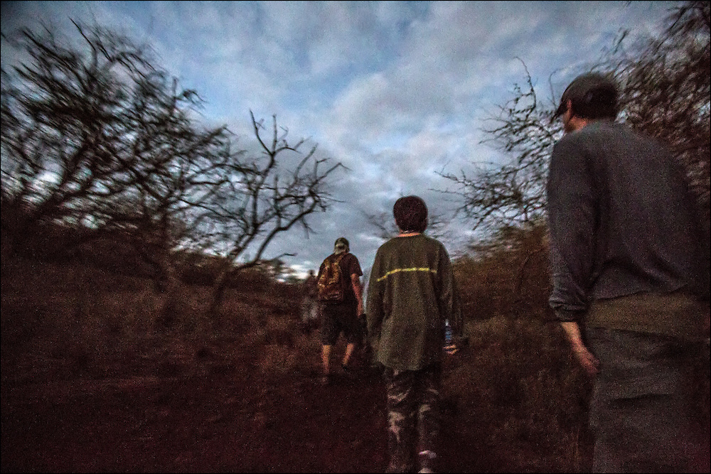 4:48am. Brother Nolan and Junior Trackers take a walk on a west Molokai trail to look for deer and turkey tracks.