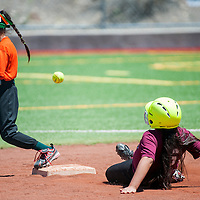 060113       Cable Hoover<br /> <br /> Diamondback Din&eacute; Coversup (6) steals second base as the throw bounces past Hurricane Savannah Watson (5) Saturday at Ford Canyon Park.