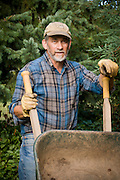 Tim Lanfri with wheel barrow at his home in Portland, Oregon.