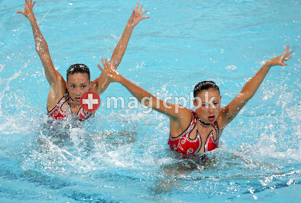 Chinese Synchronised Swimming team Beibei Gu and Xiaohuan Zhang perform in the women's Duet Free Routine final of the Athens 2004 Olympic Games Wednesday 25 August 2004.  (Photo by Patrick B. Kraemer / MAGICPBK)