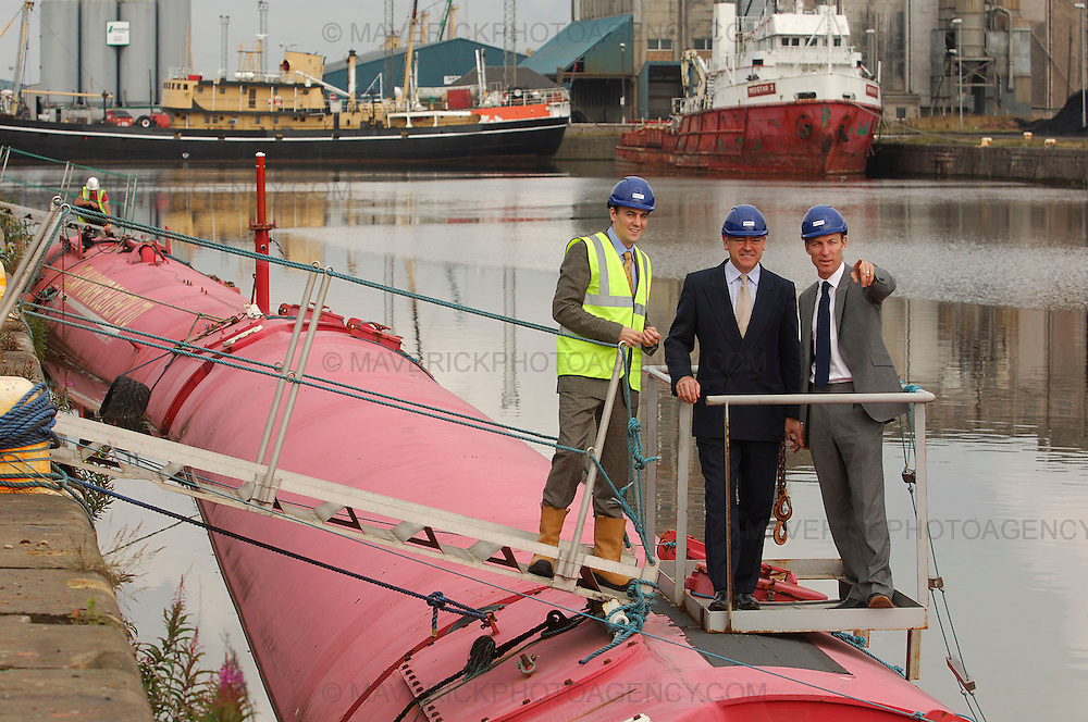 Jim Murphy announces £8 million funding for Scotland's European Marine Energy Centre (EMEC) as UK government rolls out Low Carbon Transition Plan...Picture shows Secretary of State for Scotland Jim Murphy (R) with CEO of Pelamis Wave Power Phil Metcalf and head of Pelamis' R&D Ross Henderson (L) at Pelamis' headquarters in Edinburgh.