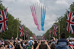 © Licensed to London News Pictures. 11/06/2016. London, UK. The Red Arrows perform a flypast down The Mall and over Buckingham Palace during Trooping of the Colour on The Queen's 90th birthday.  Photo credit : Stephen Chung/LNP