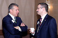 Douglas Bolton of Cassidy Turley (left) talks with AT&T external affairs director Mark Romito during the Dayton Area Chamber of Commerce Government Affairs Breakfast at the Crowne Plaza Hotel in downtown Dayton, Wednesday, November 30, 2011.