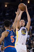 January 23, 2018; Oakland, CA, USA; Golden State Warriors guard Klay Thompson (11) shoots the basketball against New York Knicks guard Courtney Lee (5) during the third quarter at Oracle Arena. The Warriors defeated the Knicks 123-112.