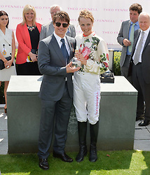 TOM CRUISE and EDIE CAMPBELL at the 2014 Glorious Goodwood Racing Festival at Goodwood racecourse, West Sussex on 31st July 2014.