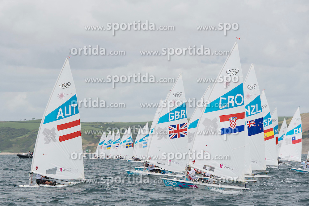 30.07.2012, Bucht von Weymouth, GBR, Olympia 2012, Segeln, im Bild Laser Standard Fleet after the start // during Sailing, at the 2012 Summer Olympics at Bay of Weymouth, United Kingdom on 2012/07/30 . EXPA Pictures © 2012, PhotoCredit: EXPA/ Juerg Kaufmann ***** ATTENTION for AUT, CRO, GER, FIN, NOR, NED, POL and SWE ONLY!