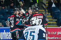 KELOWNA, CANADA - DECEMBER 3: Nick Merkley #10, Rourke Chartier #14, Tyrell Goulbourne #12 and Colten Martin #8 of Kelowna Rockets celebrates a goal against the Saskatoon Blades on December 3, 2014 at Prospera Place in Kelowna, British Columbia, Canada.  (Photo by Marissa Baecker/Shoot the Breeze)  *** Local Caption *** Colten Martin; Tyrell Goulbourne; Rourke Chartier; Nick Merkley;