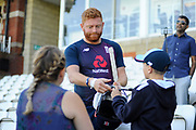 Jonny Bairstow of England signs his autograph for a young fan during the 5th International Test Match 2019 match between England and Australia at the Oval, London, United Kingdom on 14 September 2019.