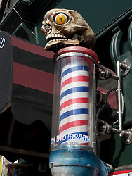 Barbers pole and skull outside the Tattoo parlour No Pain No Brain in bohemian Prenzlauer Berg District of Berlin