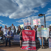 A crowd gathers carrying signs and banners in support of the immigrant rally Monday at the courthouse square in Gallup.