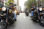 "Christian Walters, left, of Harley-Davidson, and Dorsey ""Barney"" Fyffe, right, a Wounded Warrior Project Peer Mentor, ride in the 2015 America's Parade on Veterans Day, Wednesday, Nov. 11, 2015, in New York, to announce the extension of ""Operation Personal Freedom: Ride Free,"" free Riding Academy motorcycle training to all active-duty military and veterans. (Photo by Diane Bondareff/AP Images for Harley-Davidson)"
