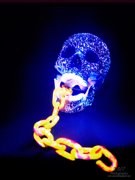 Glowing skull and chain.Black light