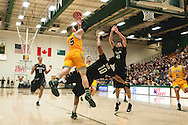 Catamounts forward Brendan Kilpatrick (15) leaps over Binghamton's Yosef Yacob (10) for a shot during the men's basketball game between the Binghamton Bearcats and the Vermont Catamounts at Patrick Gym on Monday night January 19, 2015 in Burlington, Vermont. (BRIAN JENKINS, for the Free Press)