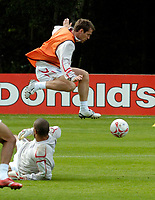 Photo: Richard Lane.<br />England Training Session. 22/05/2006.<br />Michael Owen skips over a challenge from David James during training.