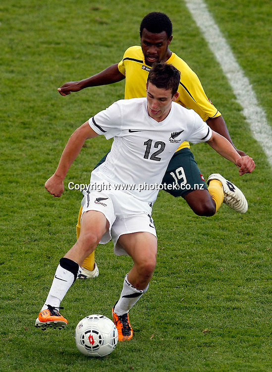NZ's Louis Fenton tangles with Vanuatu's Willie-Ola Jimmy. OFC Men's Olympic Qualifier New Zealand 2012 Semi Final, New Zealand v Vanuatu, Owen Delany Park Taupo, Friday 23rd March 2012. Photo: Shane Wenzlick