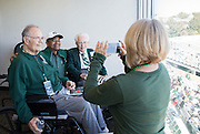 Sue Winter, far right, takes a picture of Charles J. Ping, left, Ohio University President Roderick McDavis, center, and Will Konneker, right, during the Ohio University Homecoming game on October 10, 2015 at Peden Stadium. Photo by Emily Matthews