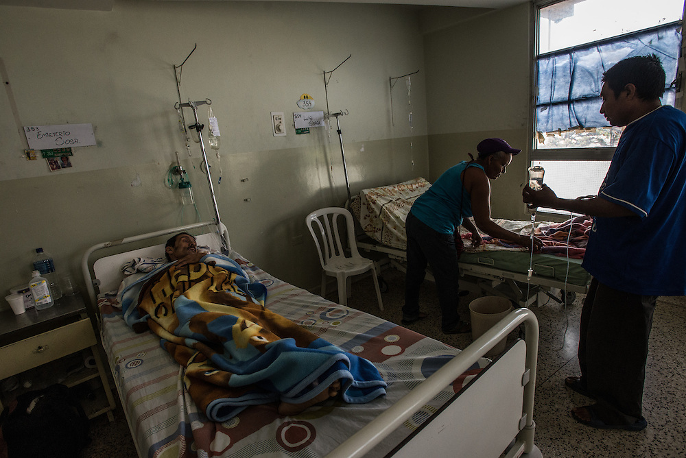 MERIDA, VENEZUELA - JANUARY 29, 2016: Patients rest at the public hospital in Merida, a sad place where news reports said there had been no water for days to wash the operating rooms.  PHOTO: Meridith Kohut for The New York Times