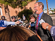 02 NOVEMBER 2010 - PHOENIX, AZ: Terry Goddard (CQ) with his wife, Monica Goddard (CQ), talks to reporters after they dropped off their ballots at Kenilworth Elementary School in Phoenix. Kenilworth is where Terry Goddard votes. Goddard lost the election to sitting Governor Jan Brewer, a conservative Republican.     PHOTO BY JACK KURTZ