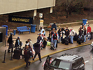 Southwest Airlines passengers wait in line as they arrive at Philadelphia International Airport December 29, 2005 in Philadelphia, Pennsylvania. (Photo by William Thomas Cain)