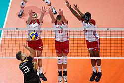23-09-2019 NED: EC Volleyball 2019 Poland - Germany, Apeldoorn<br /> 1/4 final EC Volleyball - Poland win 3-0 / Marcin Komenda #4 of Poland, Mateusz Bieniek #20 of Poland, Wilfredo Leon Venero #9 of Poland