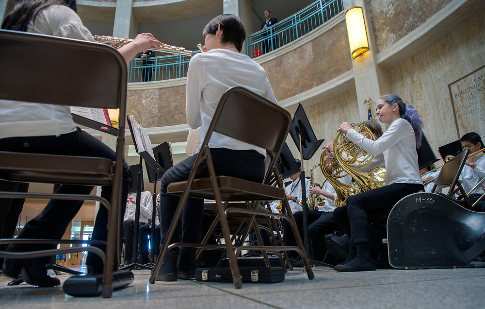 em020718f/a/Laynera Sewell and others with the Cimarron School 7th and 8th grade band perform in the Rotunda of the State Capitol in Santa Fe, Wednesday February 7, 2018.  (Eddie Moore/Albuquerque Journal)