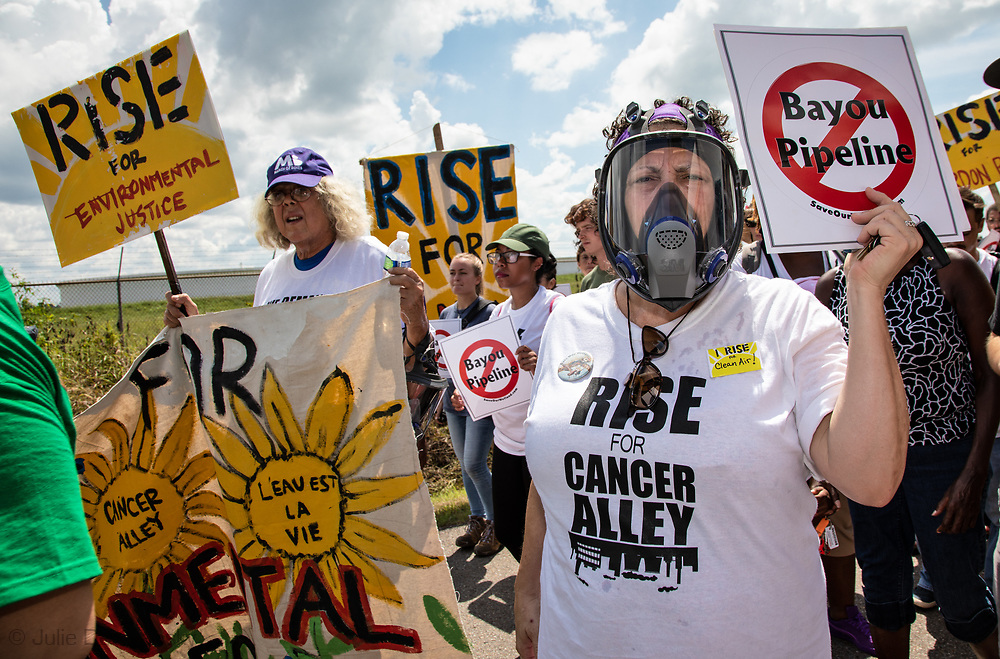 Cindy Russo, wearing a gas mask during the Rise for Cancer Alley march on Burton Lane, in St. James, Louisiana on Sept 8, 2018.