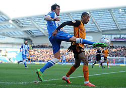 Brighton and Hove Albion's Gordon Greer is tackled by Wolverhampton Wanderers' Benik Afobe  - Photo mandatory by-line: Harry Trump/JMP - Mobile: 07966 386802 - 14/03/15 - SPORT - Football - Sky Bet Championship - Brighton v Wolves - Amex Stadium, Brighton, England.