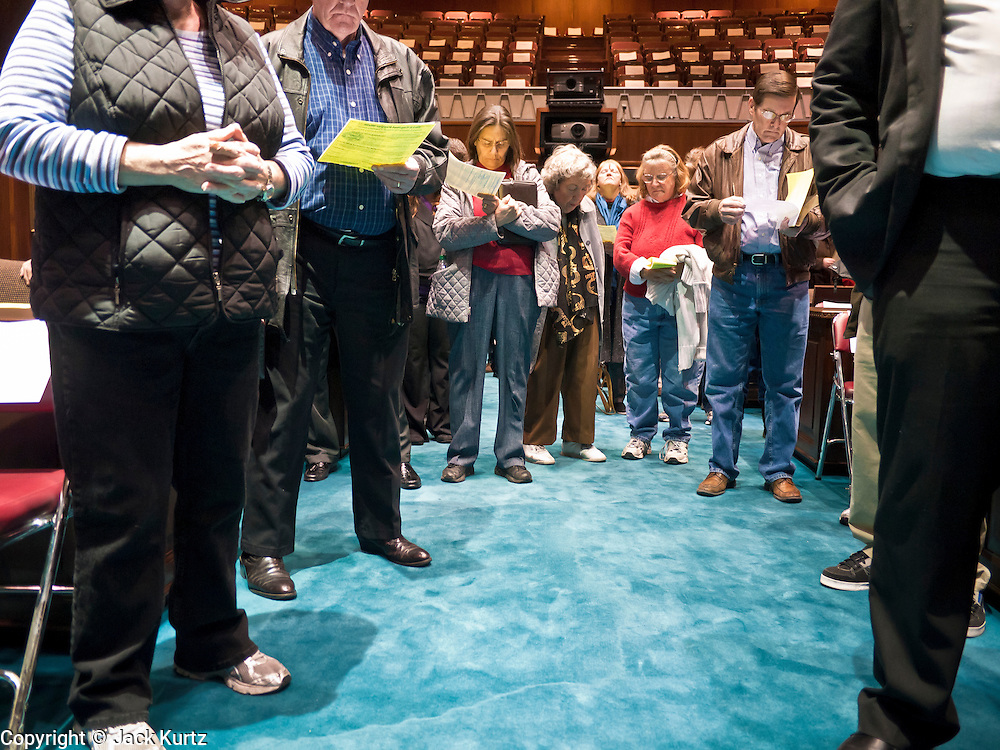 09 JANUARY 2012 - PHOENIX, AZ:   People pray in the House of Representatives during the Prayer Walk sponsored by the Center for Arizona Policy at the Arizona State Capitol in Phoenix Monday. The Arizona legislature started its 2012 session and Gov. Jan Brewer delivered her State of the State Monday, Jan 9.  PHOTO BY JACK KURTZ