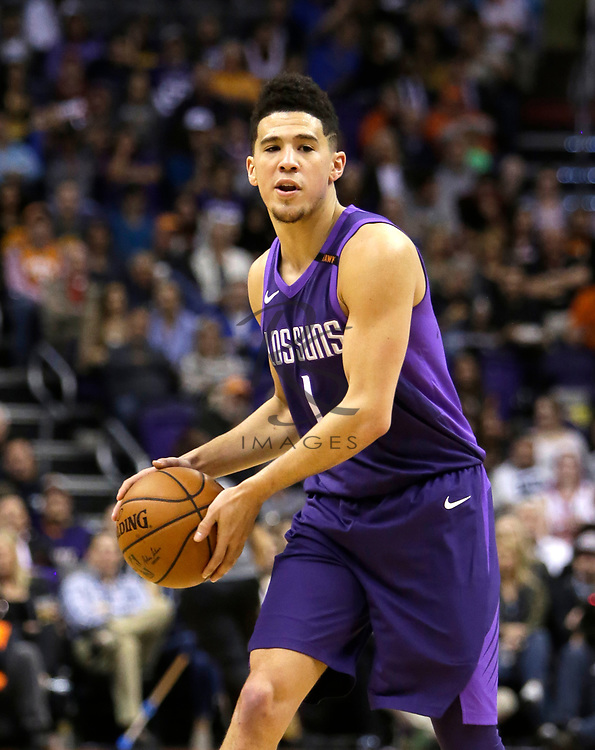 Phoenix Suns guard Devin Booker (1) in the first half during an NBA basketball game against the New York Knicks, Friday, Jan. 26, 2018, in Phoenix. (AP Photo/Rick Scuteri)