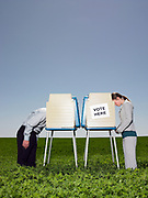 Man and woman at voting booths outdoors