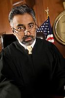 Male judge sitting in court, portrait