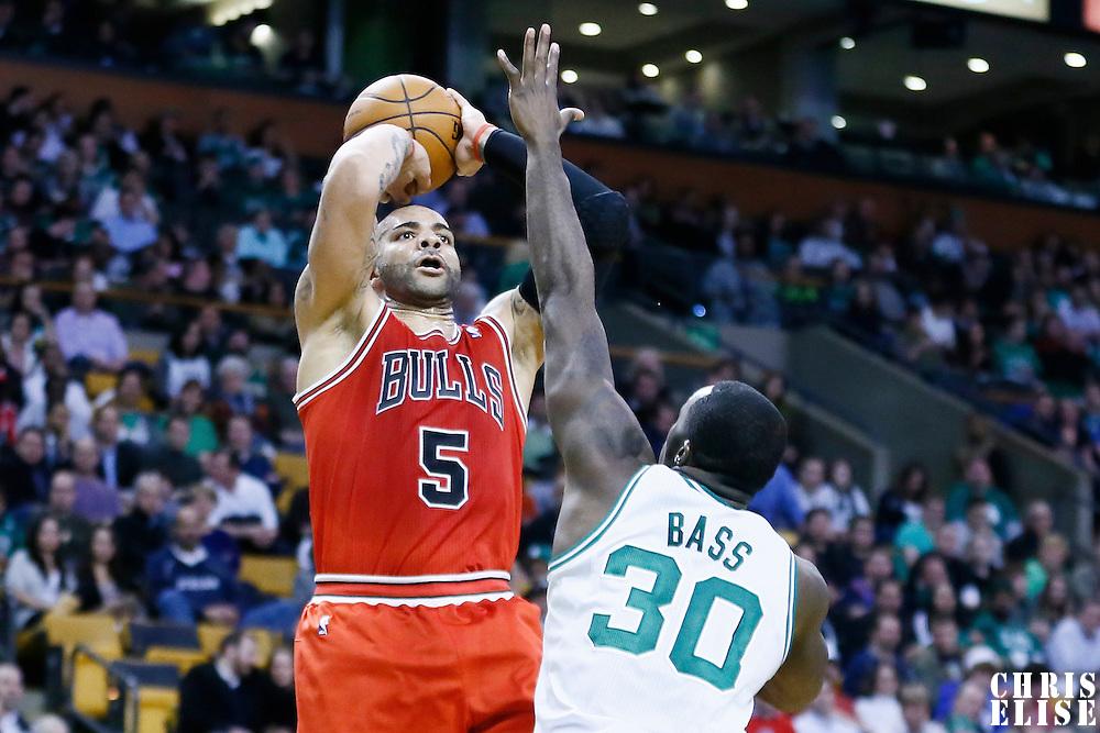 13 February 2013: Chicago Bulls power forward Carlos Boozer (5) takes a jumpshot over Boston Celtics power forward Brandon Bass (30) during the Boston Celtics 71-69 victory over the Chicago Bulls at the TD Garden, Boston, Massachusetts, USA.