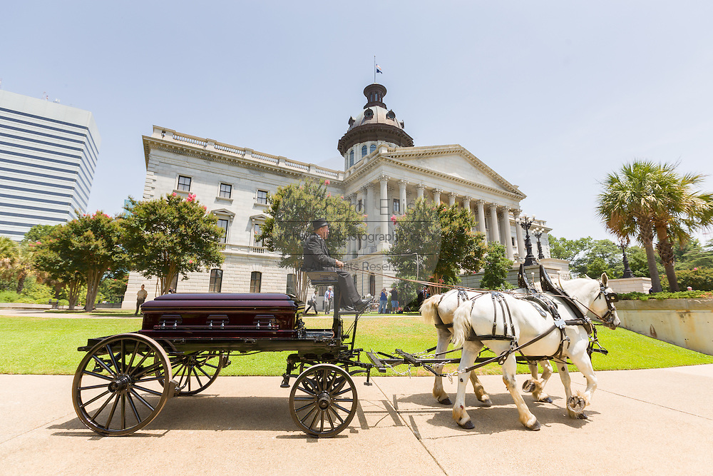 The horse-drawn caisson carrying the casket of slain State Senator Clementa Pinckney arrives at the State House for the last time June 24, 2015 in Columbia, South Carolina. Pinckney is one of the nine people killed in last weeks Charleston church massacre.