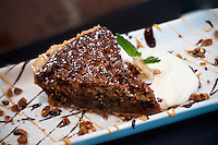 Delicious pecan pie infused with chocolate chunks and toasted coconut.
