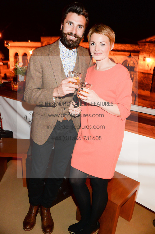 Johnnie Walker Gold Label Reserve Finale Celebration Party aboard the John Walker & Sons Voyager moored at the Prince of Wales Docks, Leith, Edinburgh, Scotland on 14th August 2013.<br /> Picture shows:-Adam Storey & Fee Storey