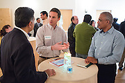 Michael Steger, center, talks with Ashwani Dhall, left, and Anand Gangadharan, right, during the World Culture Festival Bay Area Curtain Raiser event at the India Community Center in Milpitas, California, on January 20, 2016. (Stan Olszewski/SOSKIphoto)