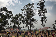 Displaced people take refuge in the grounds of a school in the town of Rutshuru, North Kivu, DRC.