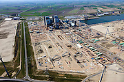 Nederland, Groningen, Eemshaven, 01-05-2013; RWE-kolencentrale in aanbouw. Overzicht bouwterrein. De Energiecentrale Eemshaven van Essent zal werken op  poederkool en biomassa.Overview construction site. WE's coal power plant under construction. Essent's Power Plant Eemshaven (under construction) will operate on pulverized coal and biomass. .luchtfoto (toeslag op standard tarieven).aerial photo (additional fee required).copyright foto/photo Siebe Swart