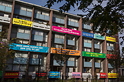 "Banners on the balconies of homes in Bowater House on the Golden Lane Estate to protest about the 10-storey luxury apartment development called The Denizen, a controversial building by Taylor Wimpey that locals say will dominate their view and block their daylight, on 30th October 2017, in London, England. Residents on the Estate have erected banners by artists Jeremy Deller and Elizabeth Price to picket the developers. Despite this, Wimpey say, ""We are one of the UK's largest residential developers. As a responsible developer we are committed to working with local people and communities."""